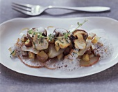 Pan-cooked potato dish with ceps and pears