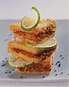 Fried bread triangles with shrimp puree and lime slices