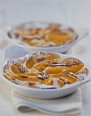 Peach brulee with icing sugar
