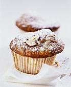 Banana muffins with hazelnuts and icing sugar