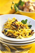 Ribbon noodles with mushrooms and pine nuts
