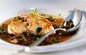 Fish medallions with shallot and lentil sauce