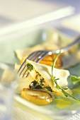 Ravioli al pesce (Fish ravioli with herbs and onions)