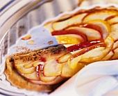 Apple pie in pie dish (piece cut)
