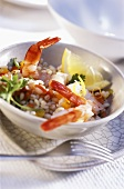 Shrimps with pepper and barley and lemon slice