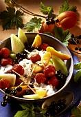 Fruit salad with cream, sunflower seeds and lemon grass