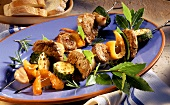 Meat kebabs with vegetables and bay leaf