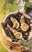 Sardines in vine leaves with ham and lemon
