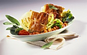 Wedge of savoy with Parma ham and sage in tomato sauce