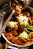 Greek pan-cooked vegetable dish with lamb, pasta and cheese