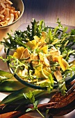 Exotic poultry salad with pineapple on curly endive