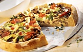 Mushroom tart with spring onions and ham