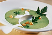 Parsley soup with Backerbsen (soup garnish)