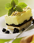 Zwieback (rusk) with muesli mousse, blueberries & sprig of mint