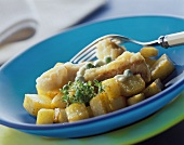 Pan-cooked fish and potato dish with peas and cress