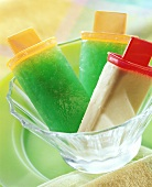 Green jelly ice cream & mango & coconut ice cream on stick
