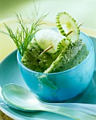 Savoury cucumber ice cream in blue bowl