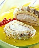 Sponge roll with hazelnut ice cream; redcurrants