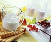 Ingredients for berry shakes: milk and fresh berries