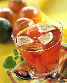 Mandarin and grapefruit punch with lime wedges