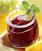 Grape punch in glass with sugared rim