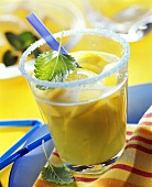 Fruit juice punch with Curacao, mango & lemon in glass