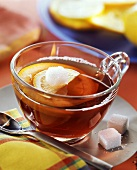 Tea punch with red wine, oranges, and sugar lumps