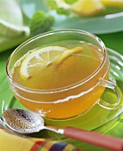 Tea punch with slices of lemon in glass cup