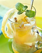 Green tea sangria with apples and lemon peel