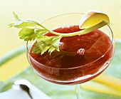 Beetroot drink garnished with celery and apple
