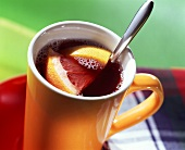 Elderberry and grape drink with pieces of grapefruit