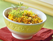Wok-cooked red lentils with papaya & coriander leaves