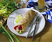 Weisswurst (white sausage) wrap with radicchio & celery; beer