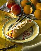 Pomegranate and orange wrap with sesame praline