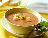 Creamed tomato soup with croutons and parsley