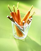 Carrots with cigarettes in glass