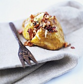 Potato stuffed with bacon on fabric napkin
