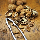 Walnuts, some opened, with nut crackers