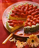 Carrot cake with strawberries, a piece cut