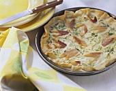 Trout quiche with spring onions in baking dish