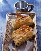 Sheep's cheese & spinach börek with pine nuts in basket