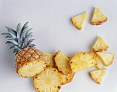 Pineapple, cut into slices and pieces