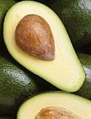 Avocados, one halved