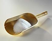 Salt on wooden scoop