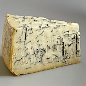 Wedge-shaped piece of gorgonzola
