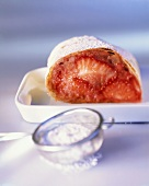 Strawberry strudel with icing sugar