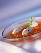 Tomato broth with basil dumplings