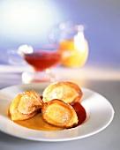 Frittelle di ricotta (ricotta fritters in fruit sauce)