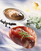 Beef steak with rosemary, pepper and spicy sauce
