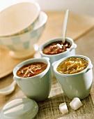 Various jams in pots; sugar lumps